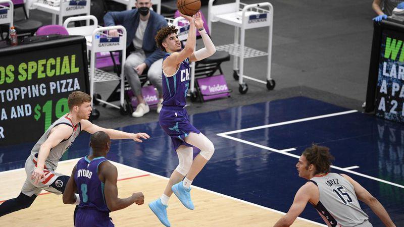 Charlotte Hornets guard LaMelo Ball (2) shoots against Washington Wizards forward Davis...