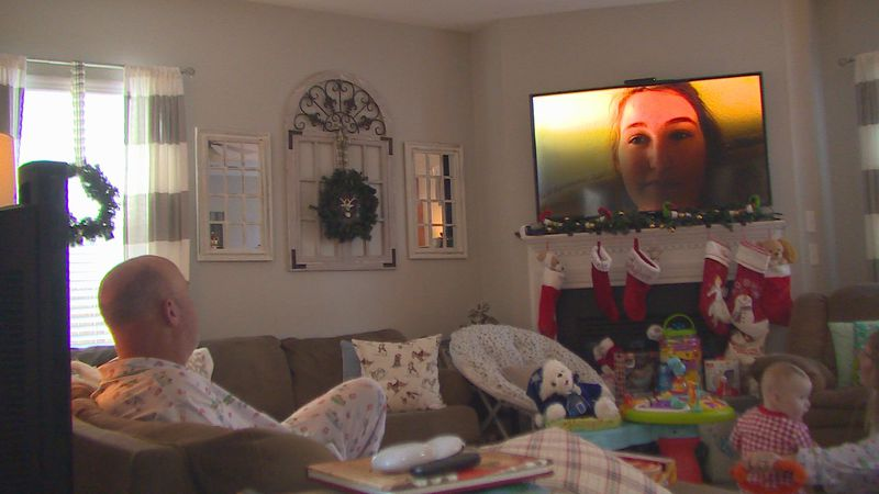 Airman 1st Class Taylor Hochschild video calls into her family's Christmas morning from...