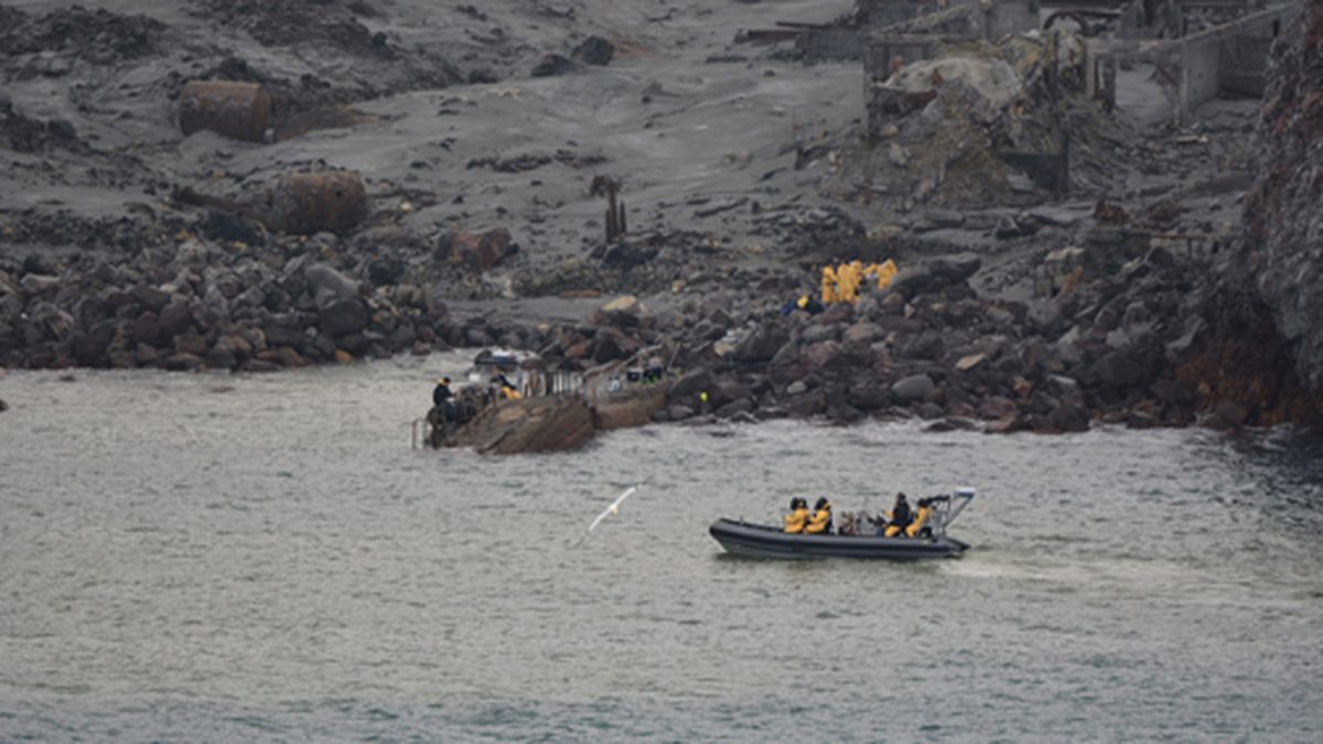 This photo released by the New Zealand Defence Force shows an operation to recover bodies from White Island after a volcanic eruption in Whakatane, New Zealand, Friday, Dec. 13, 2019. A team of eight New Zealand military specialists landed on White Island early Friday to retrieve the bodies of victims after the Dec. 9 eruption. (New Zealand Defence Force via AP)