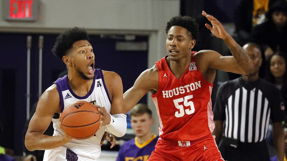 East Carolina's Jayden Gardner looks to pass the ball while defended by Houston's Brison...