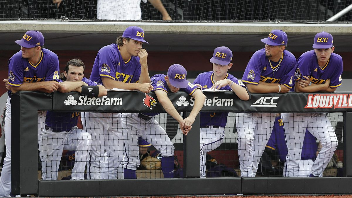 East Carolina players watch from the dugout during the ninth inning in Game 1 of an NCAA college baseball super regional tournament against Louisville, Friday, June 7, 2019, in Louisville, Ky. Louisville won 14-1. (AP Photo/Darron Cummings)