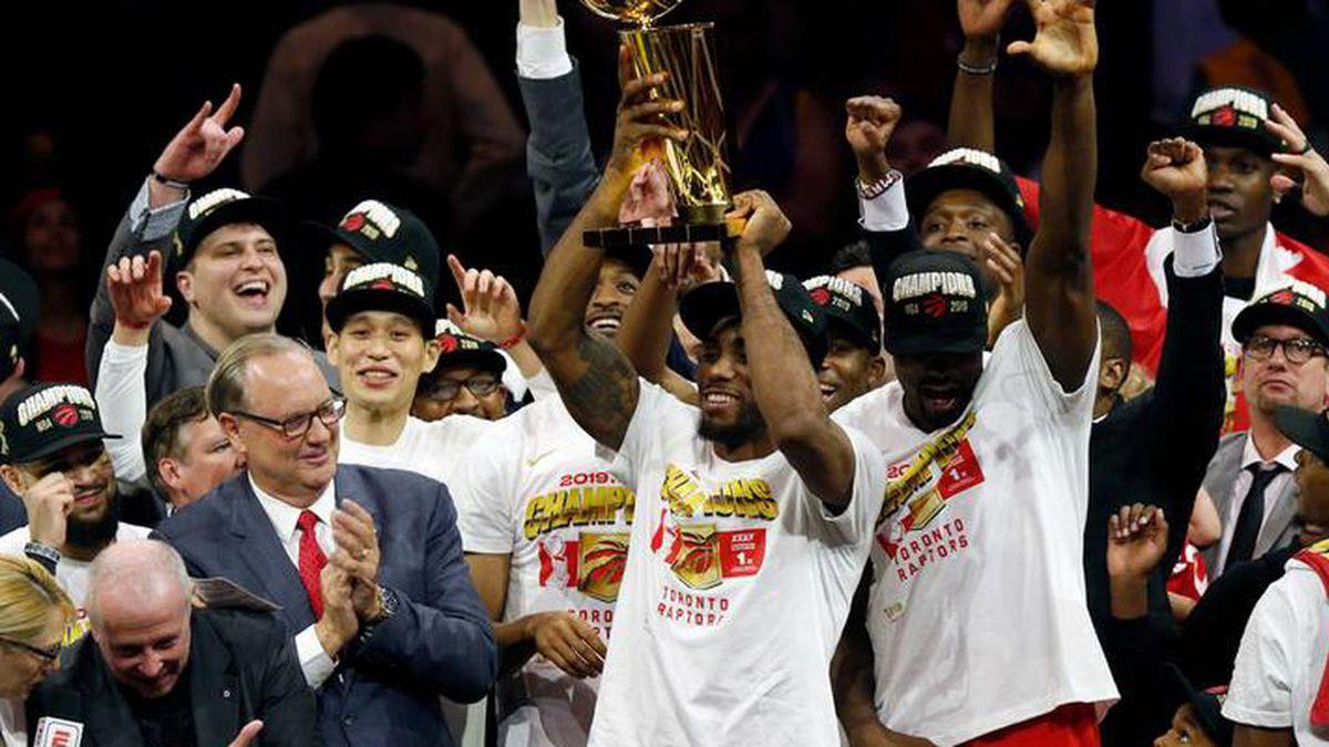 Toronto Raptors center Serge Ibaka, left, guard Kyle Lowry, center, and guard Danny Green,...