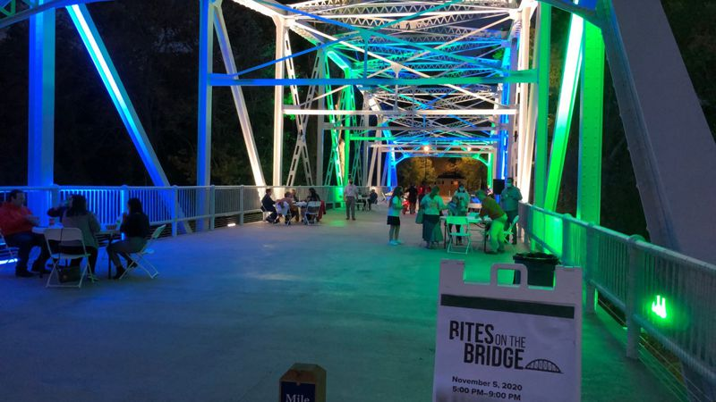 Greenville residents enjoy dinner on the newly renovated Pedestrian Bridge.
