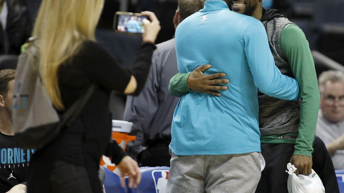 Boston Celtics' Kemba Walker, a former Charlotte Hornet, hugs old friends before an NBA basketball game between the teams in Charlotte, N.C., Thursday, Nov. 7, 2019. (AP Photo/Bob Leverone)