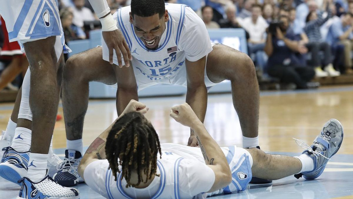 North Carolina forward Garrison Brooks (15) congratulates guard Cole Anthony following a play against North Carolina State during the second half of an NCAA college basketball game in Chapel Hill, N.C., Tuesday, Feb. 25, 2020. (AP Photo/Gerry Broome)