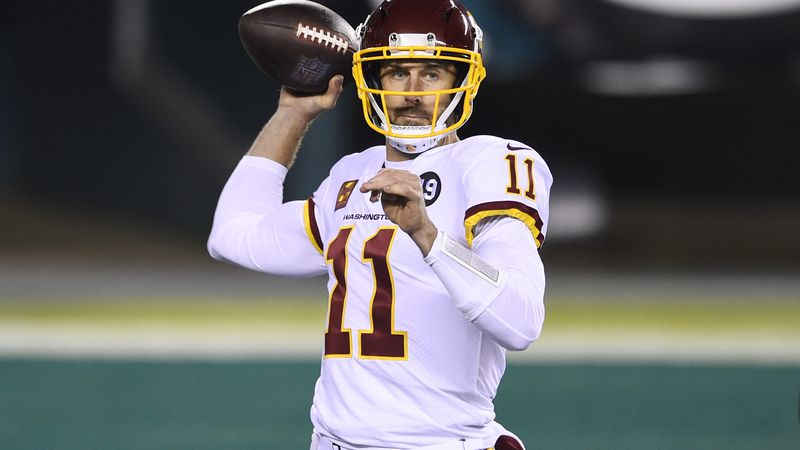 Washington Football Team's Alex Smith plays during the first half of an NFL football game...