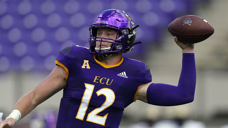 East Carolina quarterback Holton Ahlers (12) passes against Central Florida during the first...