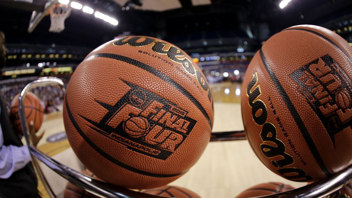 FILE - In this April 3, 2015, file photo, basketballs sit in a rack during Michigan State practice at the Final Four of the NCAA college basketball tournament in Indianapolis. NCAA President Mark Emmert says NCAA Division I basketball tournament games will be played without fans in the arenas because of concerns about the spread of coronavirus. (AP Photo/David J. Phillip, File)
