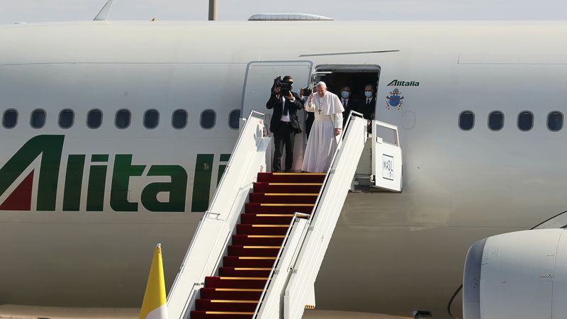 Pope Francis boards a plane upon concluding his visit to Iraq at the Baghdad airport, Iraq,...