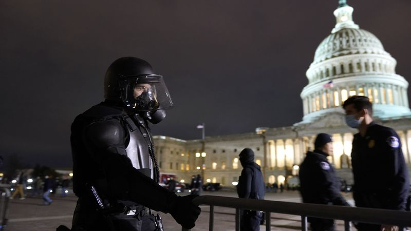 Authorities secure the area outside the U.S. Capitol, Wednesday, Jan. 6, 2021, in Washington....