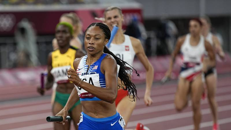 Allyson Felix, of the United States, runs in the women's 4 x 400-meter relay at the 2020 Summer...