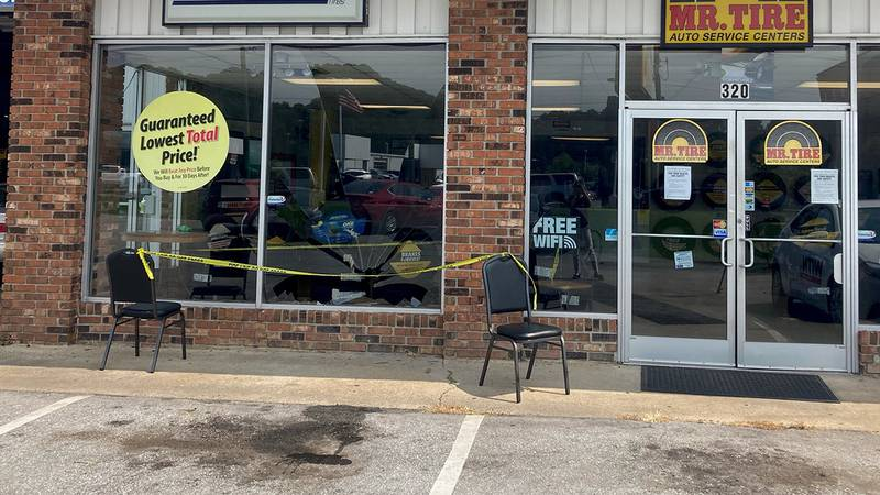 The front window was hit after a vehicle jumped the curb Friday morning.