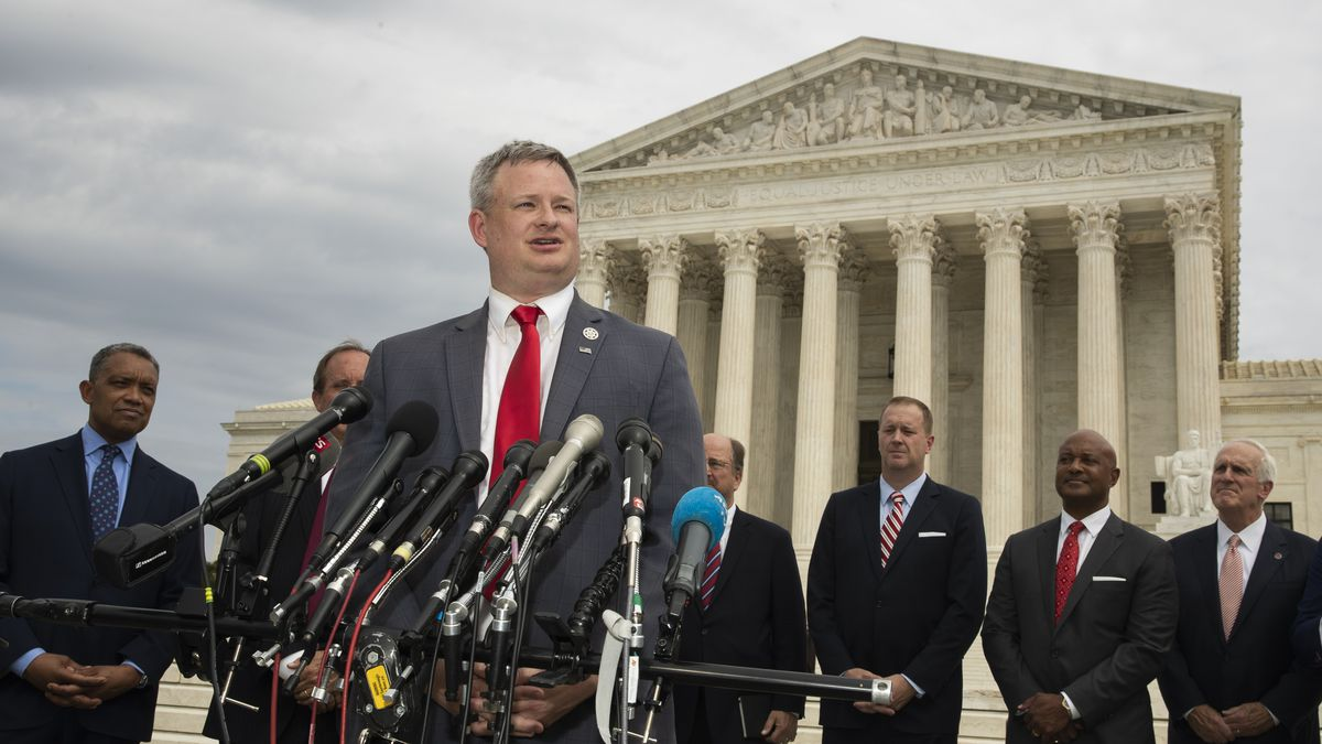 South Dakota Attorney General Jason Ravnsborg with a bipartisan group of state attorneys general speaks to reporters in front of the U.S. Supreme Court in Washington, Monday, Sept. 9, 2019.