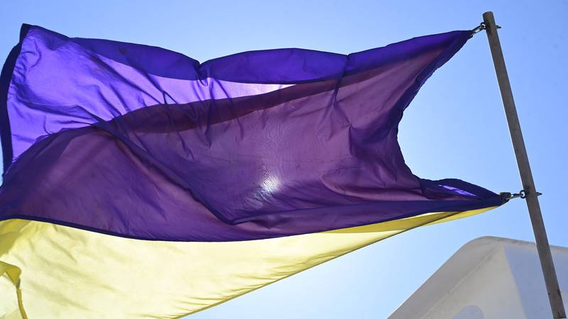 Purple and yellow flags fly on Saturday at Emerald Isle beaches.