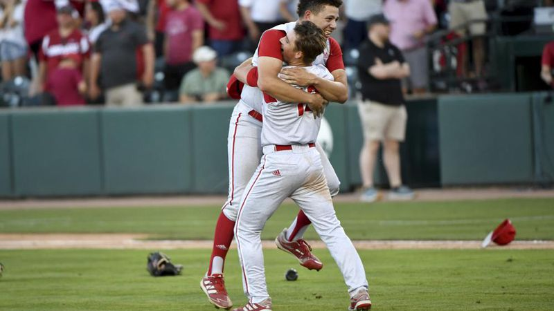 North Carolina State players Chris Villaman (left) and Tyler McDonough (right) celebrate after...