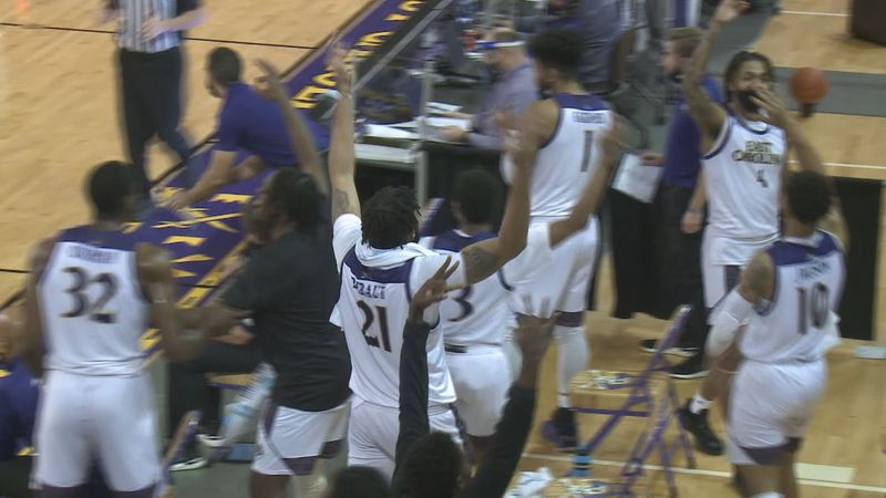 ECU men's basketball bench gets excited after made bucket