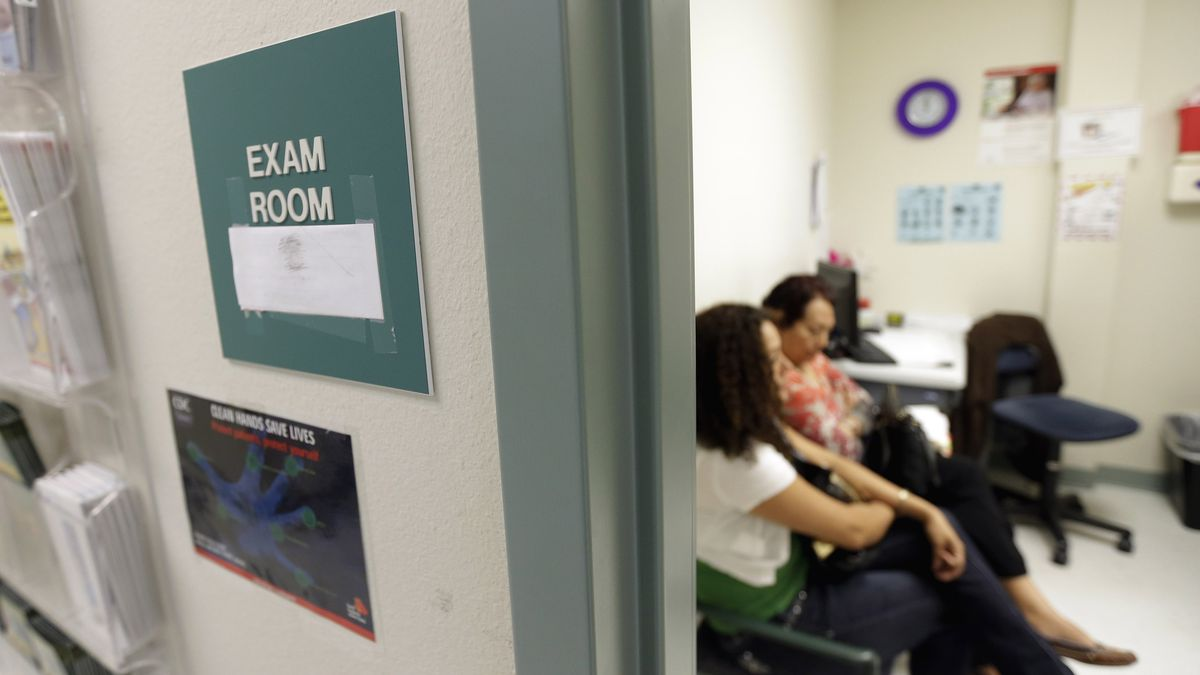 FILE - In this July 12, 2012 file photo, two women wait in an exam room at Nuestra Clinica Del...