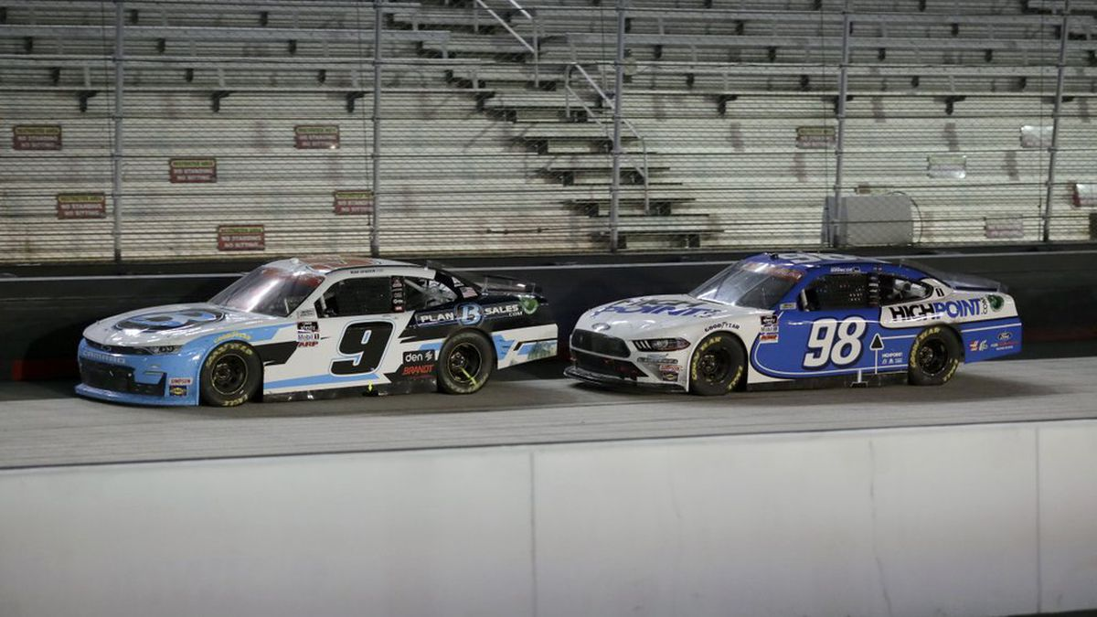 Noah Gragson (9) drives to victory past Chase Briscoe (98) during NASCAR Xfinity Series auto race at Bristol Motor Speedway Monday, June 1, 2020, in Bristol, Tenn. (AP Photo/Mark Humphrey)
