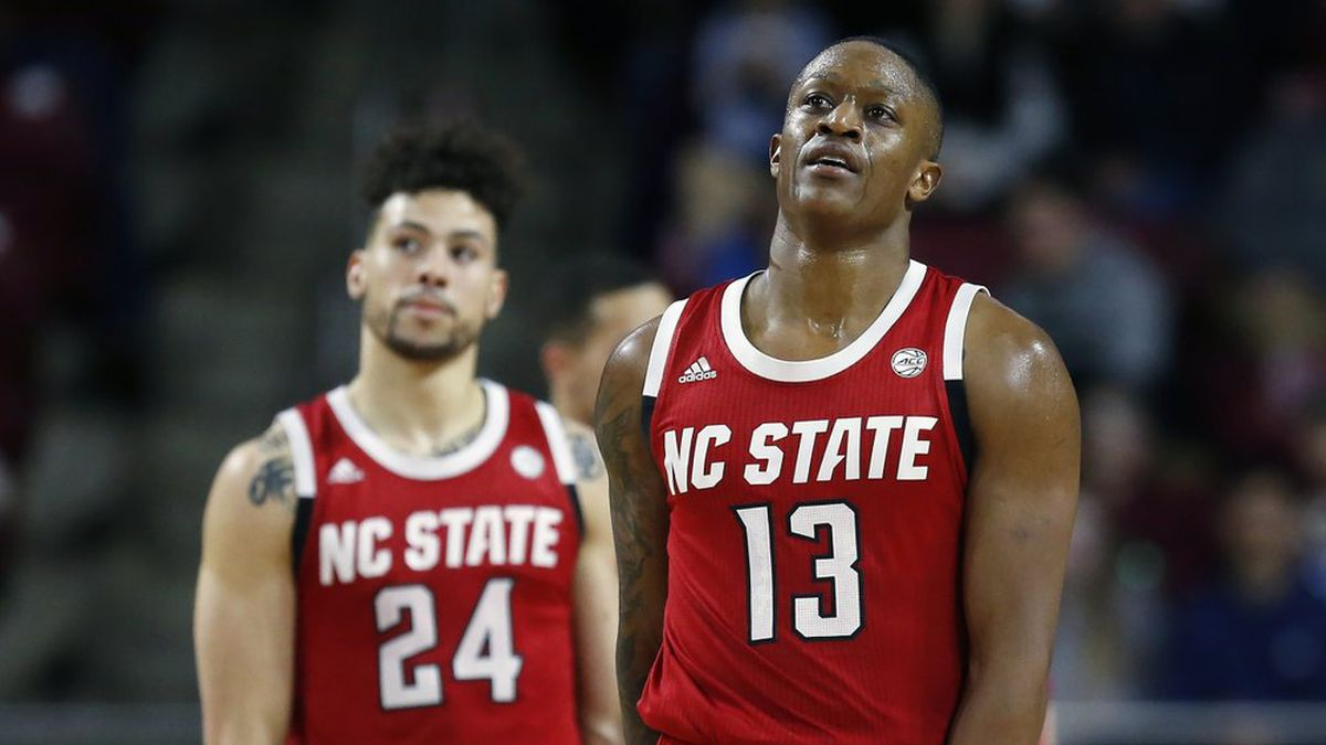 North Carolina State's C.J. Bryce (13) and Devon Daniels (24) react during the second half of an NCAA college basketball game against Boston College in Boston, Sunday, Feb. 16, 2020. (AP Photo/Michael Dwyer)