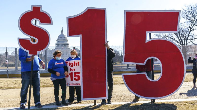 Activists appeal for a $15 minimum wage near the Capitol in Washington, Thursday, Feb. 25,...