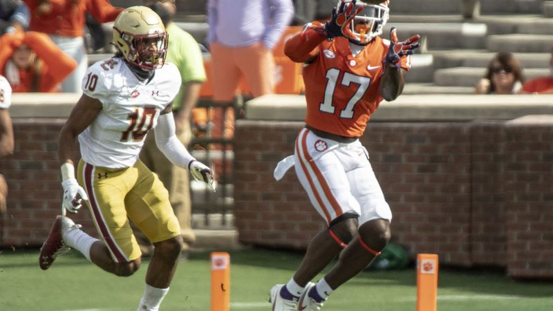 Clemson wide receiver Cornell Powell(17) catches a pass near Boston College defensive back...