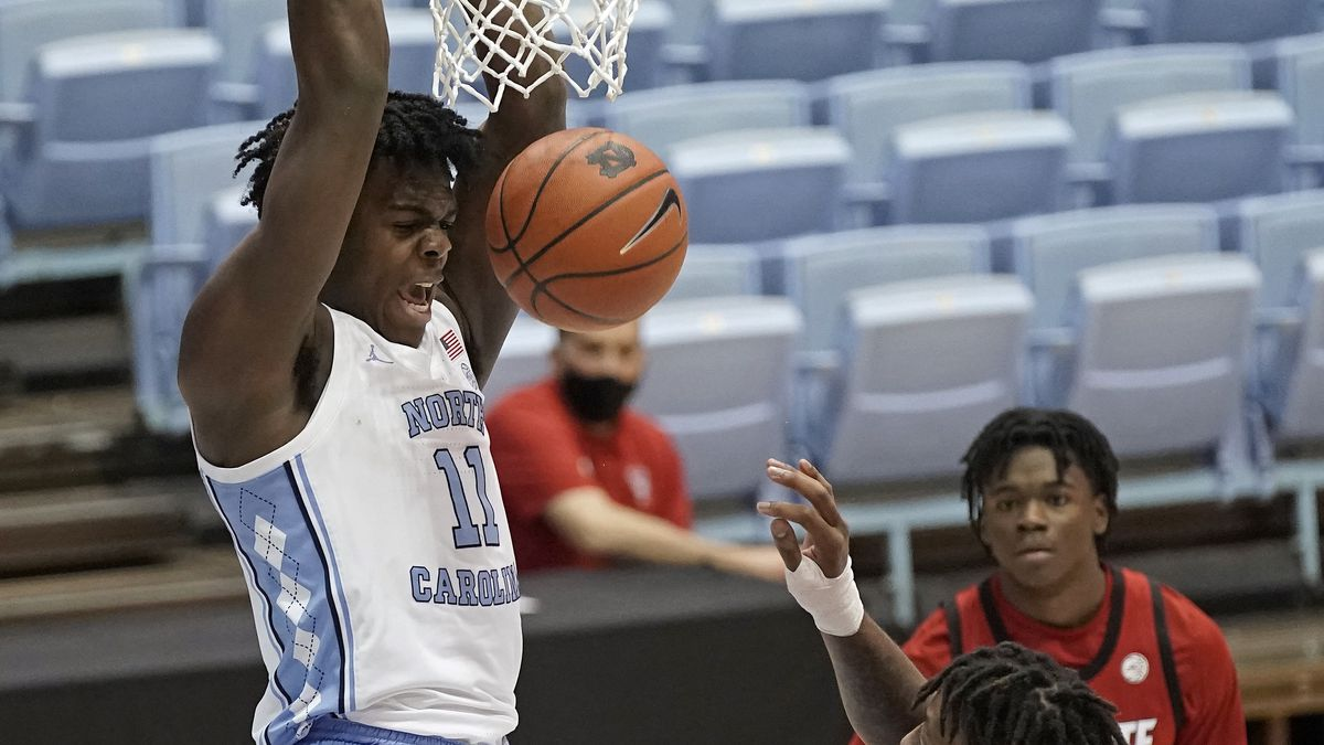 North Carolina forward Day'Ron Sharpe (11) dunks against North Carolina State during the first...