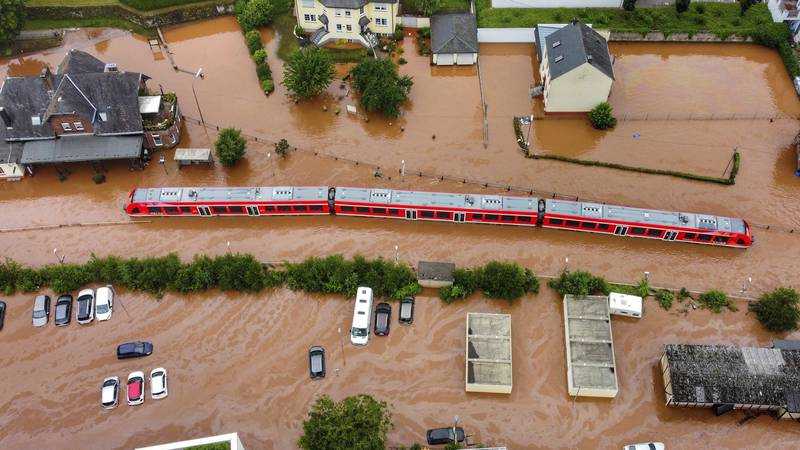A regional train sits in the flood waters at the local station in Kordel, Germany, Thursday...