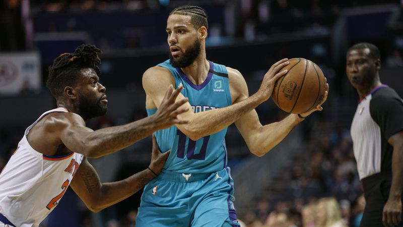 Charlotte Hornets forward Caleb Martin, right, keeps the ball from New York Knicks guard Reggie...