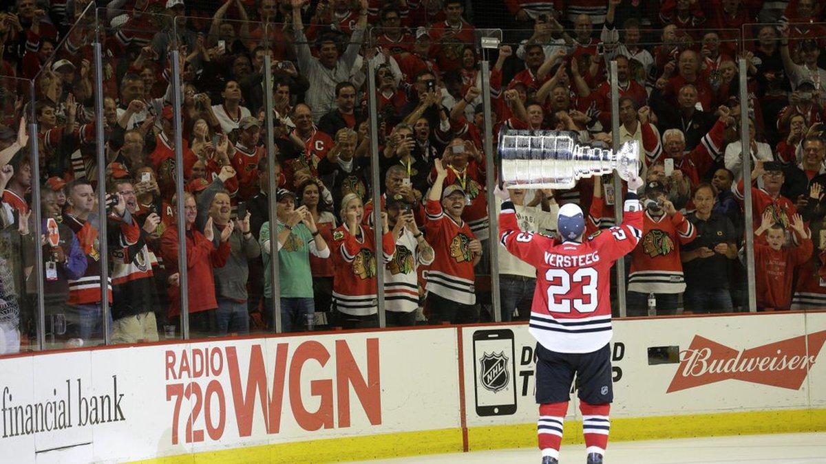 FILE - In this June 15, 2015, file photo, fans cheer as Chicago Blackhawks' Kris Versteeg...