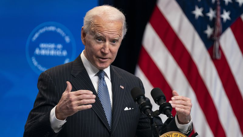 FILE - In this Jan. 25, 2021, file photo, President Joe Biden answers questions from reporters...