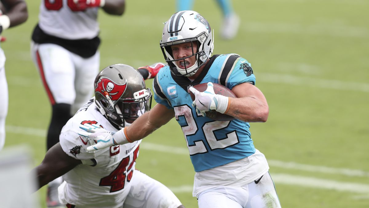Carolina Panthers running back Christian McCaffrey (22) scores against the Tampa Bay Buccaneers during the second half of an NFL football game Sunday, Sept. 20, 2020, in Tampa, Fla. (AP Photo/Mark LoMoglio)