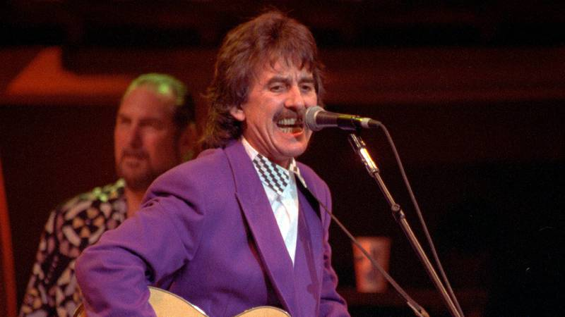 FILE - Former Beatle George Harrison performs during the Bob Dylan anniversary concert at New...