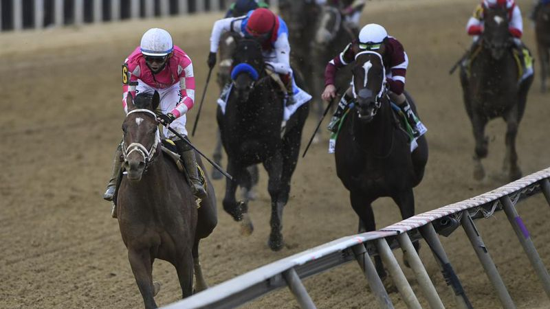 Flavien Prat atop Rombauer, left, wins the 146th Preakness Stakes horse race at Pimlico Race...
