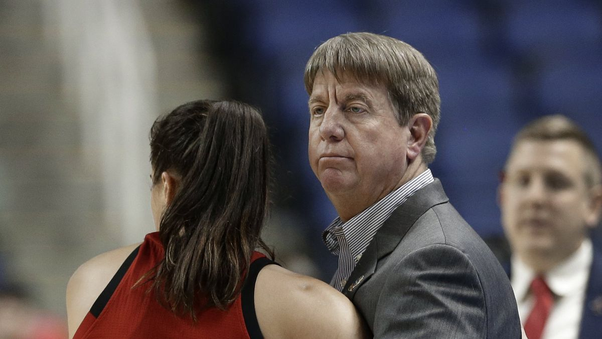North Carolina State head coach Wes Moore, right, hugs Aislinn Konig (1) during the second half of a regional women's college basketball game against Iowa in the NCAA Tournament in Greensboro, N.C., Saturday, March 30, 2019. (AP Photo/Gerry Broome)