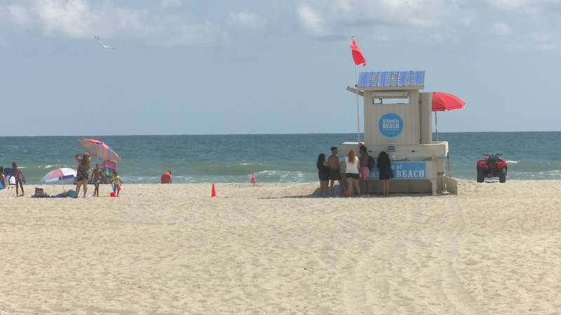 Red flags few at Atlantic Beach on Friday as Henri moved offshore.