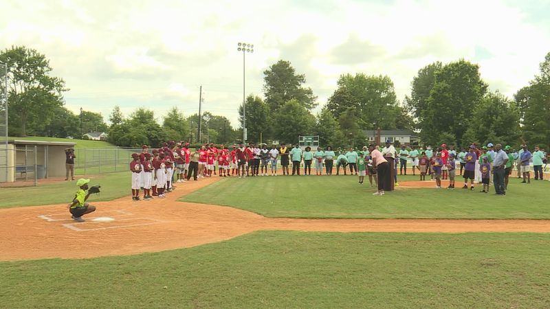 Sheriff Paula Dance threw the first pitch at Jackie Robinson League opener.
