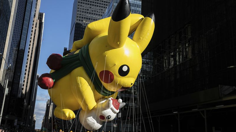 A Pikachu balloon makes its way down New York's Sixth Avenue during the Macy's Thanksgiving Day...