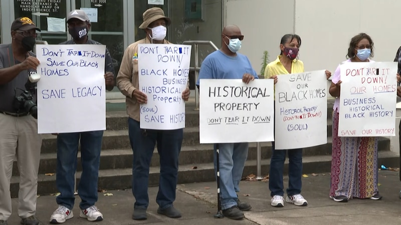 """Kinston """"Saving Our Unique Legacy"""" protests the condemning of buildings."""
