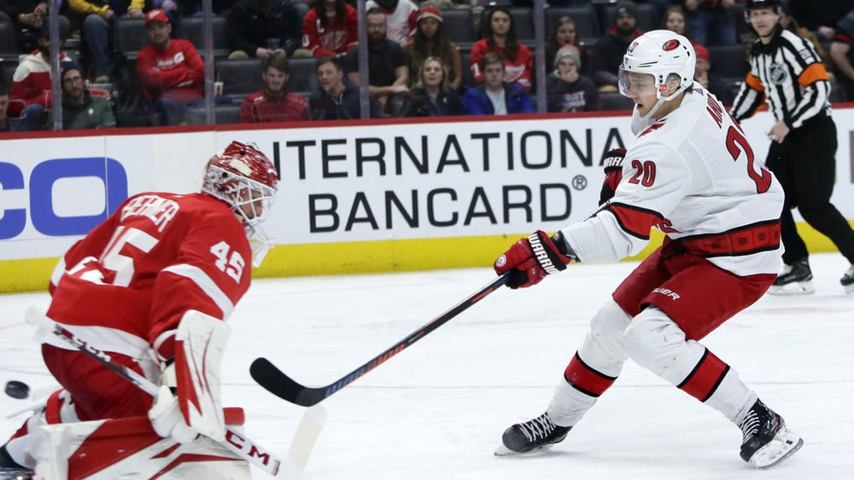 Carolina Hurricanes center Sebastian Aho (20) scores on Detroit Red Wings goaltender Jonathan Bernier (45) during the third period of an NHL hockey game Tuesday, March 10, 2020, in Detroit. (AP Photo/Duane Burleson)