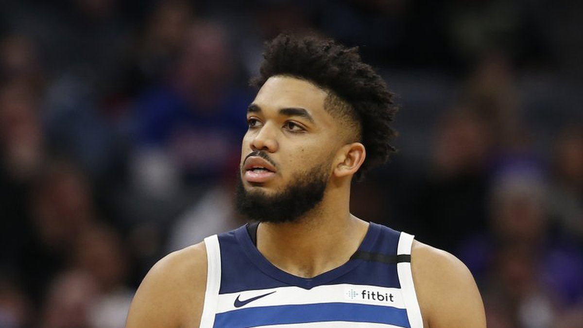 FILE - In this Feb. 3, 2020, file photo, Minnesota Timberwolves center Karl-Anthony Towns is...