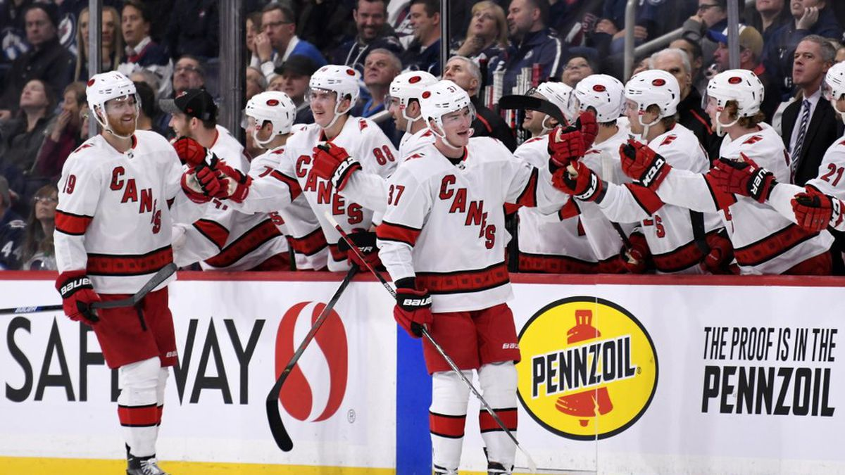 Carolina Hurricanes' Andrei Svechnikov (37) celebrates his goal against the Winnipeg Jets with teammates during second period NHL hockey action in Winnipeg, Manitoba on Tuesday Dec. 17, 2019. (Fred Greenslade/The Canadian Press via AP)