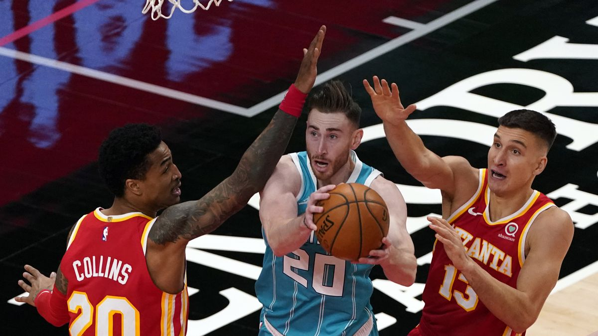 Charlotte Hornets forward Gordon Hayward (20) works between Atlanta Hawks' John Collins (20)...