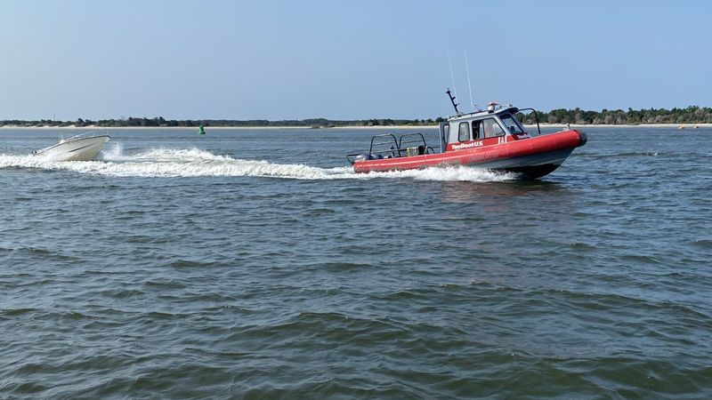 4 people were rescued this morning after their boat capsized in the Beaufort Inlet.