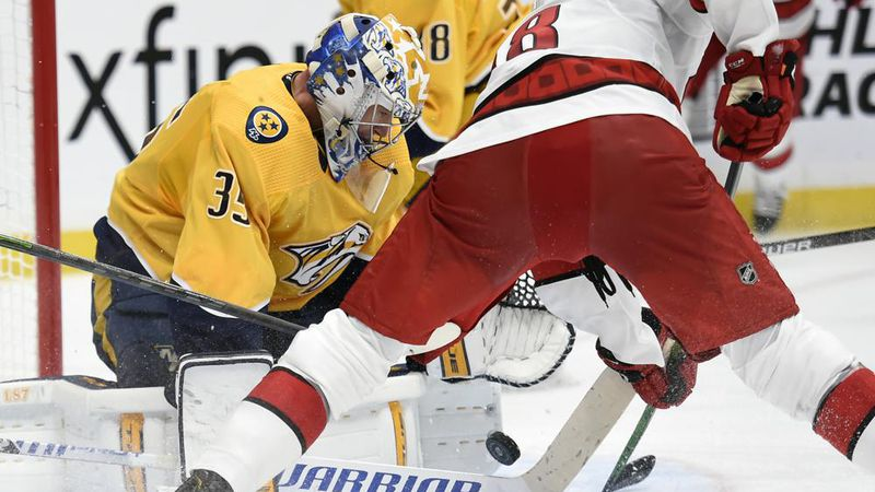 Nashville Predators goaltender Pekka Rinne (35) blocks a shot by Carolina Hurricanes left wing...