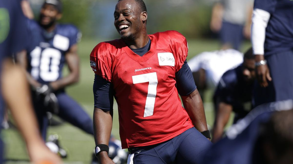 """FILE - In this July 27, 2014, file photo, Seattle Seahawks quarterback Tarvaris Jackson smiles while stretching at an NFL football camp practice in Renton, Wash. Former NFL quarterback Tarvaris Jackson has died in a one-car crash outside Montgomery, Ala., authorities said Monday, April 13, 2020. He was 36. The 2012 Chevrolet Camaro that Jackson was driving went off the road, struck a tree and overturned at 8:50 p.m. Sunday, Trooper Benjamin """"Michael"""" Carswell, an Alabama Law Enforcement Agency spokesman, said in a news release. Jackson was pronounced dead at a hospital. (AP Photo/Elaine Thompson, File)"""