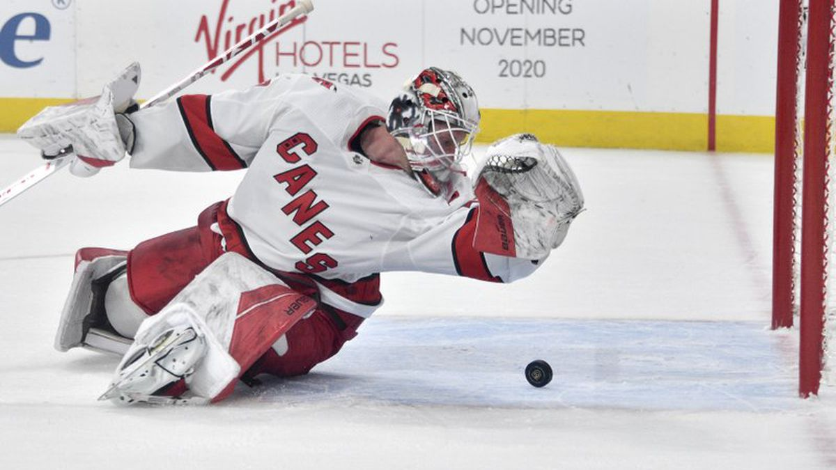 Carolina Hurricanes goaltender James Reimer makes a save against the Vegas Golden Knights during overtime in an NHL hockey game Saturday, Feb. 8, 2020, in Las Vegas. (AP Photo/David Becker)