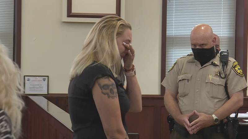 Mother of infant emotional in court.