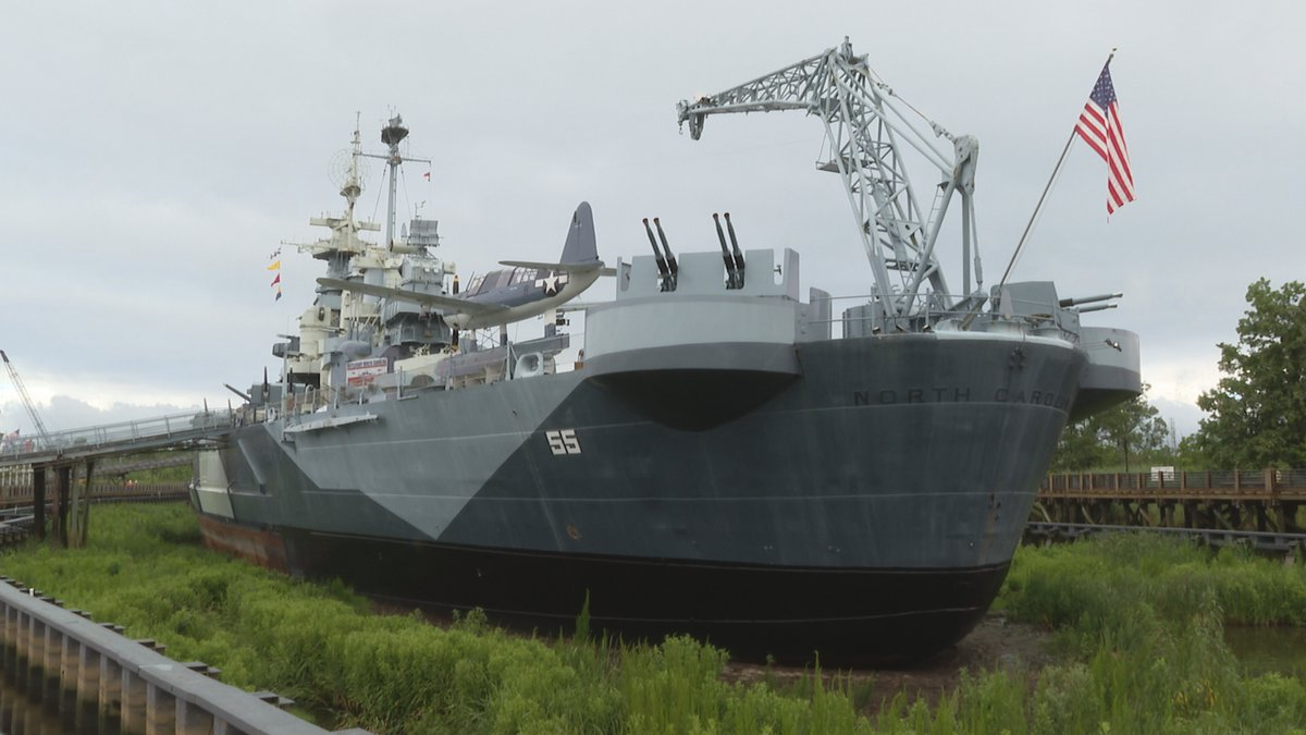 Officials began refilling the cofferdam area around the battleship during a ceremony Tuesday...