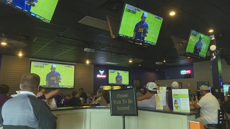 Pirate fans watch the ECU-Vandy opener at Tie Breakers on Friday.