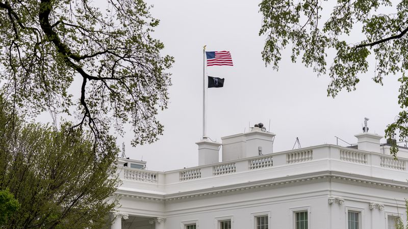 A POW/MIA flag, symbolizing America's Missing in Action and Prisoners of War, flies along with...